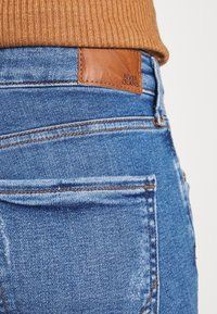 River Island - AMELIE - Jeans Skinny Fit - mid wash - 4