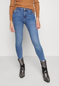 River Island - AMELIE - Jeans Skinny Fit - mid wash - 0