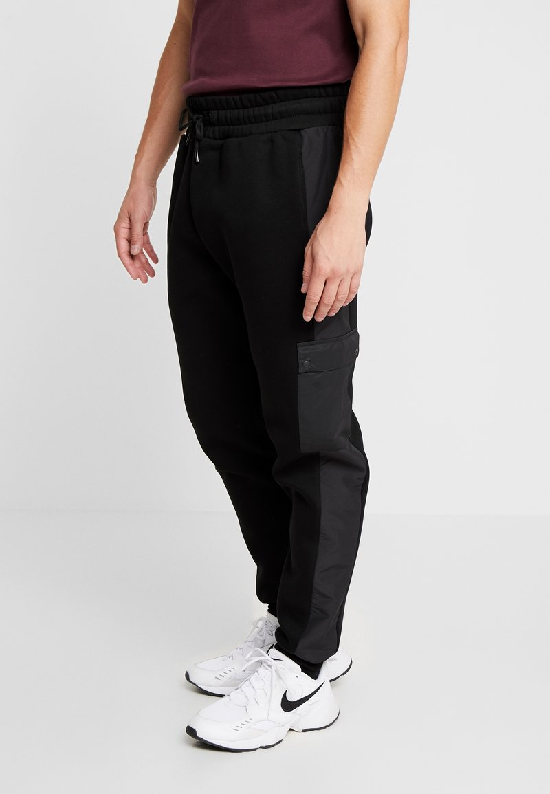 River Island - Teplákové kalhoty - black