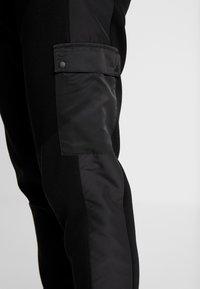 River Island - Teplákové kalhoty - black - 5