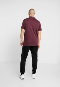 River Island - Teplákové kalhoty - black - 2