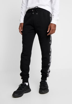 NAVAH  - Jogginghose - black