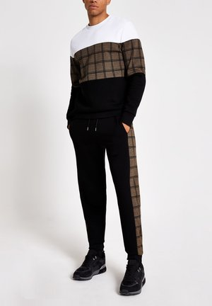 SLIM FIT - Tracksuit bottoms - black