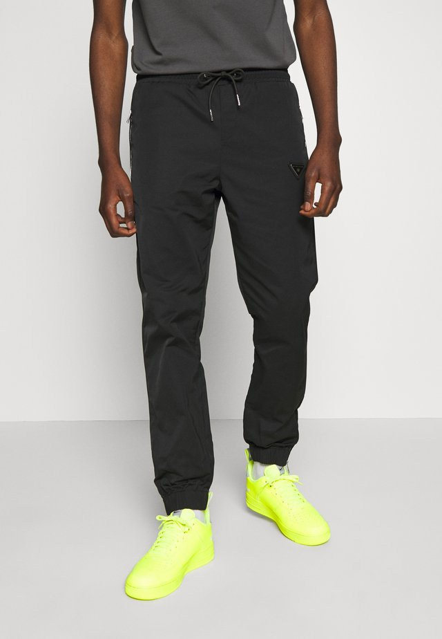 DYER TRACKPANT - Tracksuit bottoms - black
