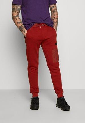 Teplákové kalhoty - rust