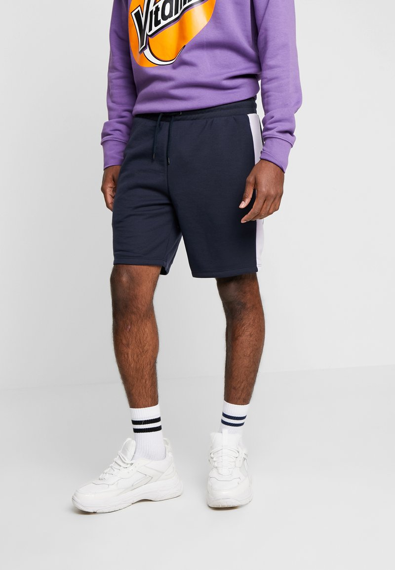 River Island - Tracksuit bottoms - navy/lilac