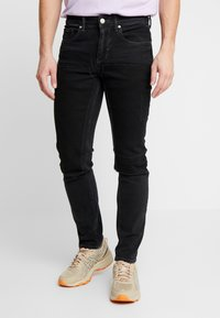 River Island - Slim fit jeans - black - 0