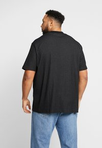 River Island - BLACK HIGH NECK TRAM STRIPE - Print T-shirt - black - 2