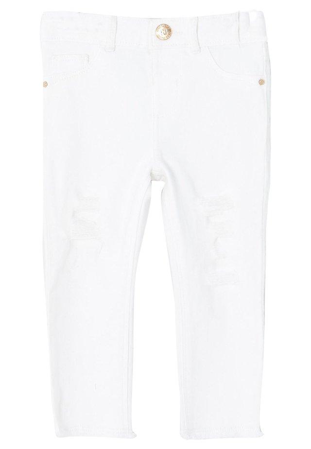 Farkkuleggingsit - white
