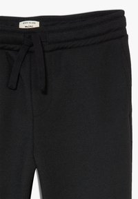 River Island - Pantalon de survêtement - black - 2