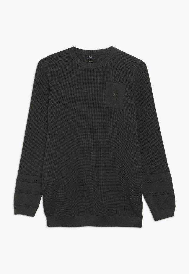 Stickad tröja - khaki