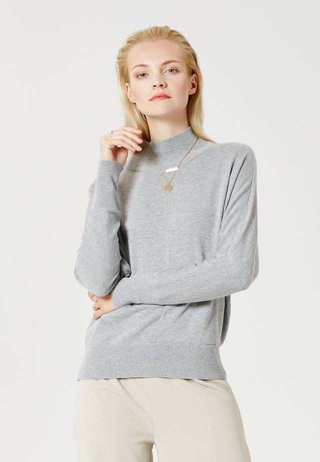 Stickad tröja - light grey