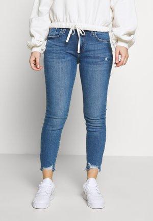 AMELIE RUBY - Slim fit jeans - mid wash
