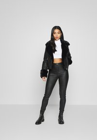 River Island Petite - PETITE KATNSS FUR CUFF BIKER - Faux leather jacket - black - 1
