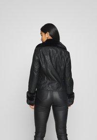 River Island Petite - PETITE KATNSS FUR CUFF BIKER - Faux leather jacket - black - 2