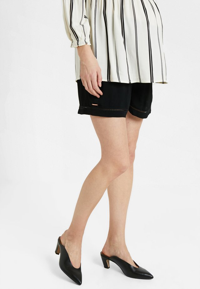 CUT IT OUT - Shorts - black