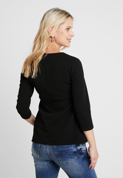 Ripe WAFFLE PEPLUM WITH SLEEVE - Bluzka z długim rękawem - black Koszulki i Topy CTJG-VX3 piękny