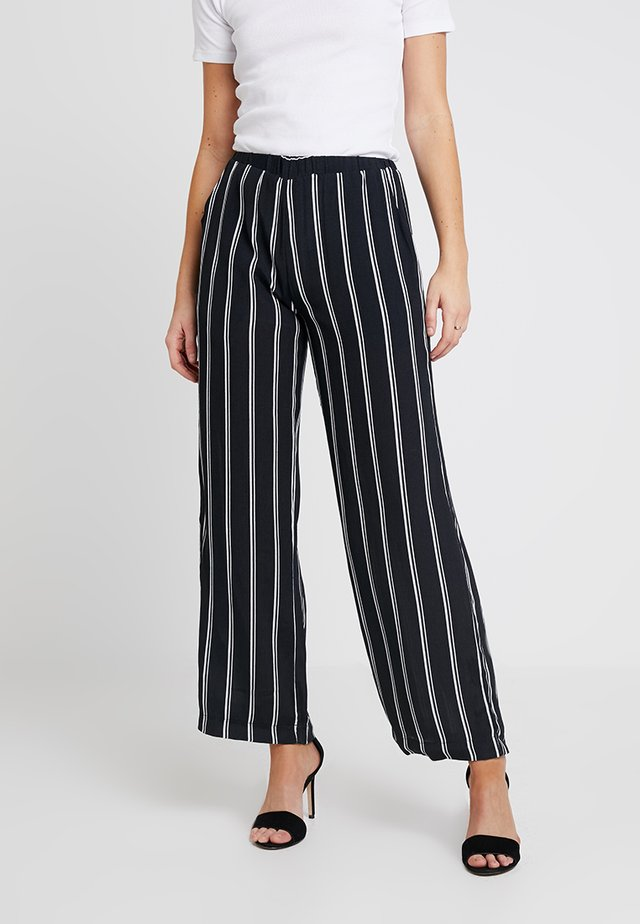 TULA STRIPE PANTS - Trousers - black