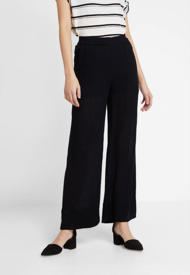TARITA PANTS - Bukse - black