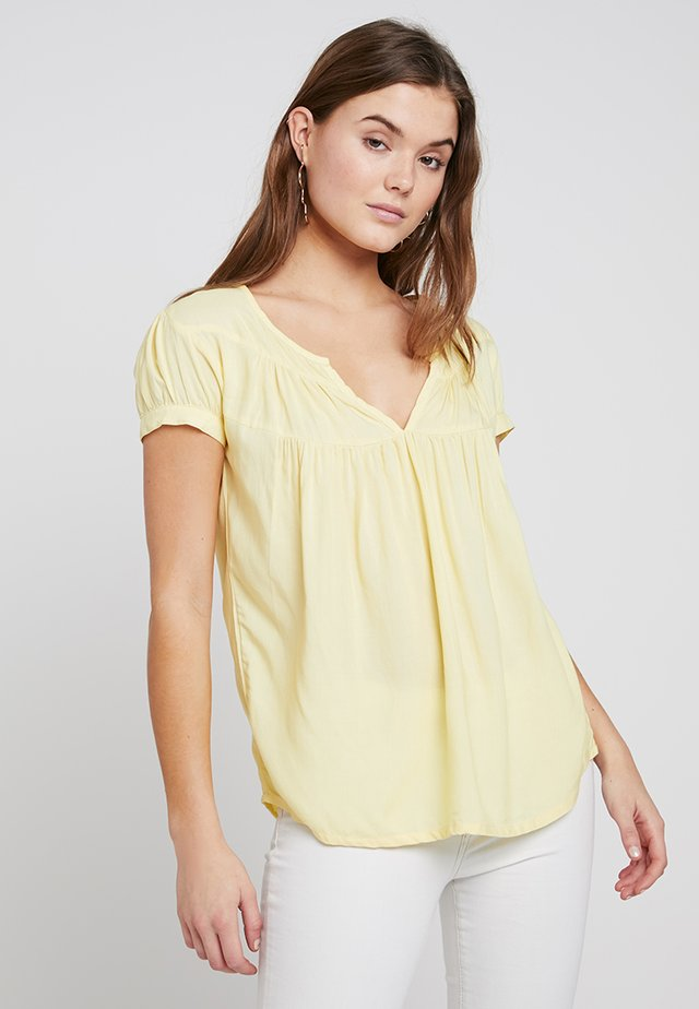 TARA - Pusero - pastel yellow