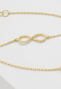 Orelia - INFINITY BRACELET - Armband - pale gold-coloured