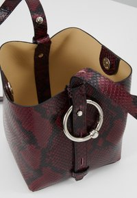 Rebecca Minkoff - MINI KATE BUCKET PYTHON - Handbag - pinot noir - 4