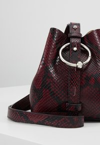 Rebecca Minkoff - MINI KATE BUCKET PYTHON - Handbag - pinot noir - 7