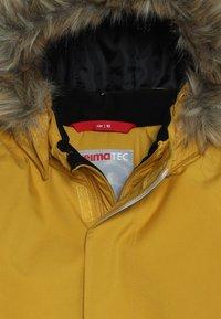 Reima - MUTKA - Winterjas - dark yellow - 4