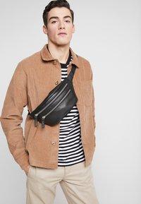 Royal RepubliQ - RIOT BUMBAG - Bum bag - black - 1