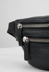 Royal RepubliQ - RIOT BUMBAG - Bum bag - black - 7