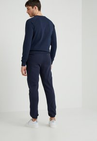 Ron Dorff - EYELET EDITION - Tracksuit bottoms - navy - 2