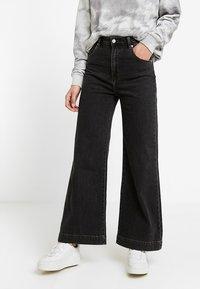 Rolla's - OLD MATE - Flared jeans - black denim - 0