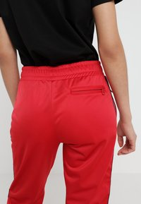 Rossignol - TRACKSUIT PANT - Bukse - red - 3