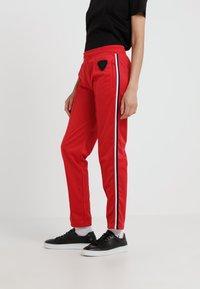 Rossignol - TRACKSUIT PANT - Bukse - red - 0