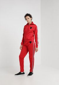Rossignol - TRACKSUIT PANT - Bukse - red - 1