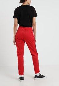 Rossignol - TRACKSUIT PANT - Bukse - red - 2
