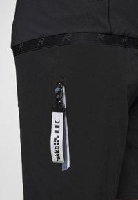 Rukka - RAINIO 2-IN-1 - kurze Sporthose - black - 6