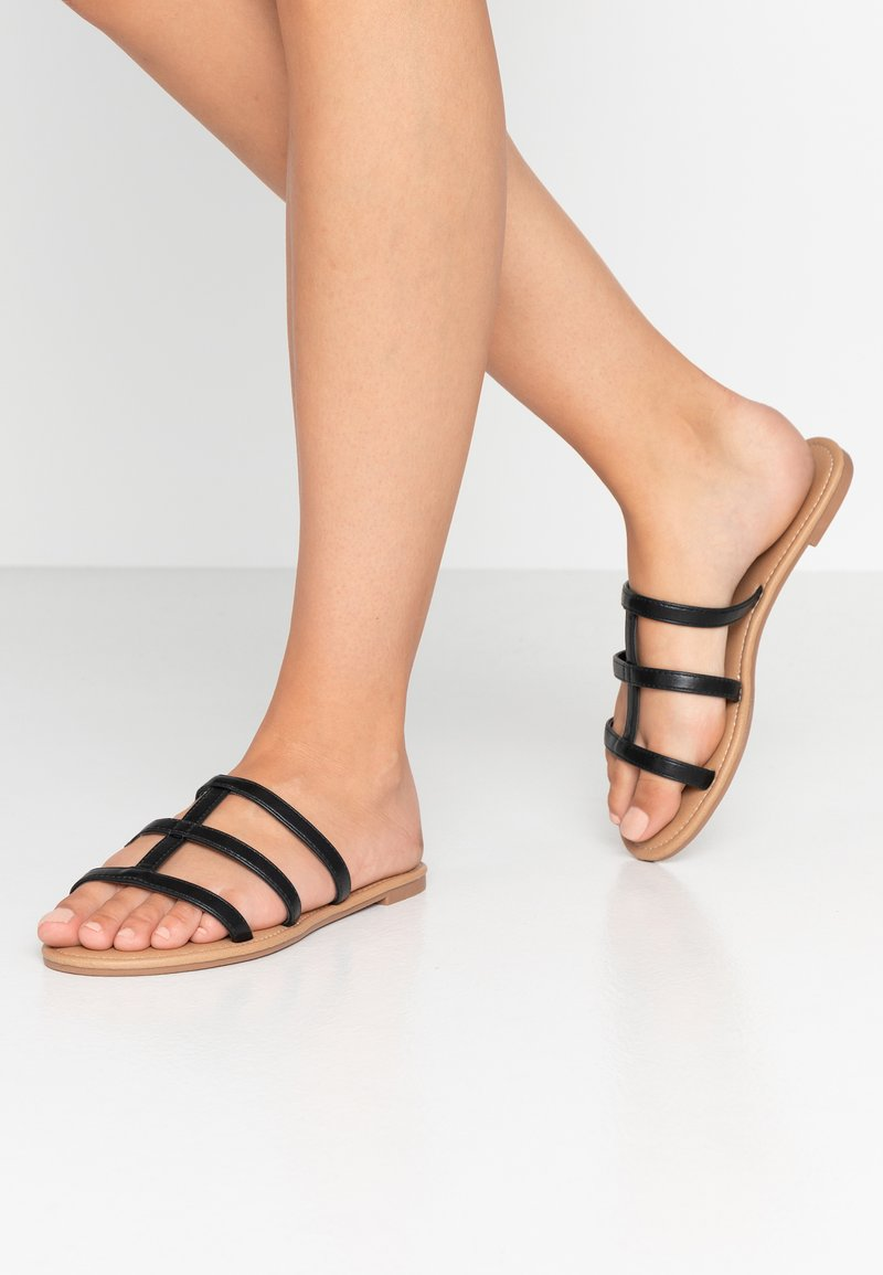 Rubi Shoes by Cotton On - EVERYDAY CAGED SLIDE - Matalakantaiset pistokkaat - black