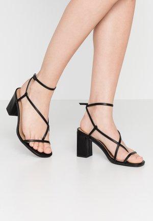 HARPER STRAPPY HEEL - Sandaalit nilkkaremmillä - black