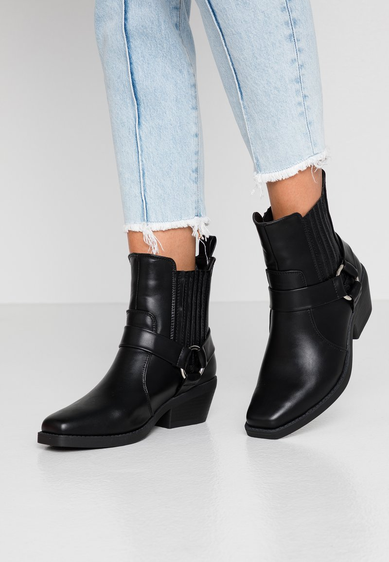 Rubi Shoes by Cotton On - TARA HARNESS SQUARE TOE BOOT - Cowboy/biker ankle boot - black