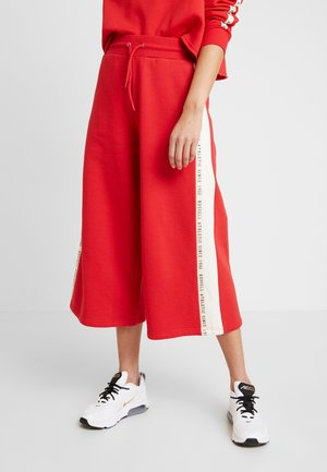 MICHELLE CULOTTES - Tracksuit bottoms - red