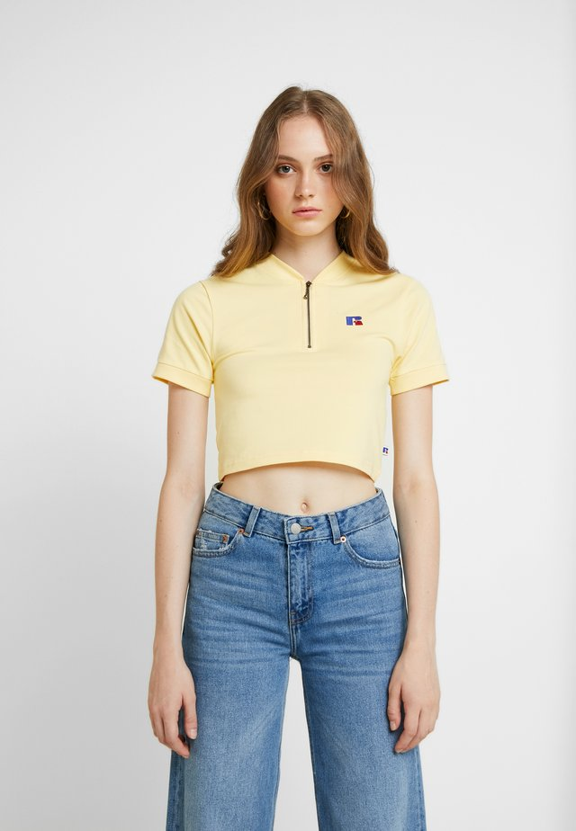 AMY - T-shirt imprimé - yellow