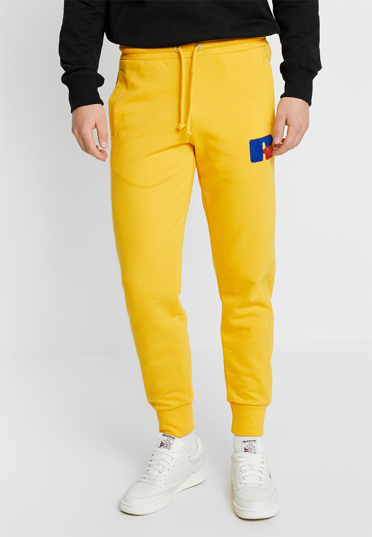 Russell Athletic Eagle R - AUSTIN-CUFFED - Jogginghose - yellow