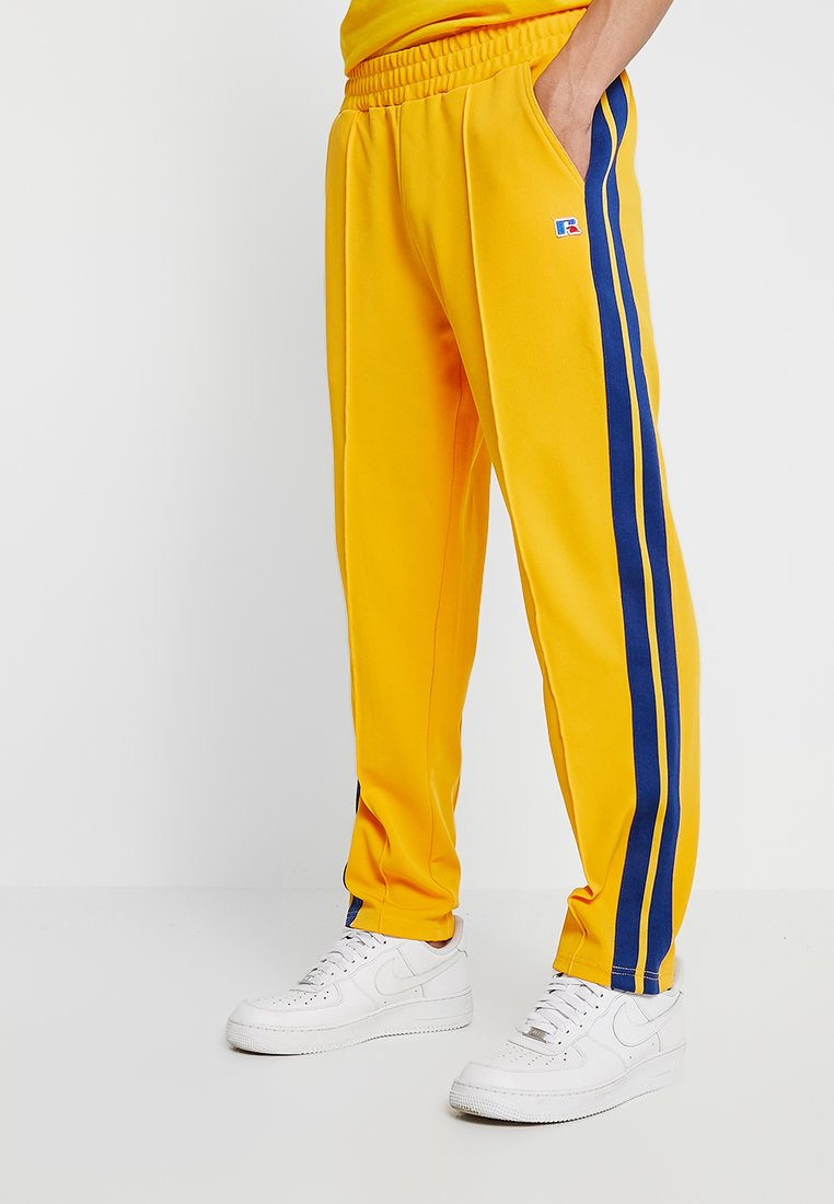 Russell Athletic Eagle R - GLAMIS STRIPED ZIP OFF TRACK PANT - Tracksuit bottoms - yellow
