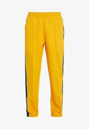 GLAMIS STRIPED ZIP OFF TRACK PANT - Trainingsbroek - yellow