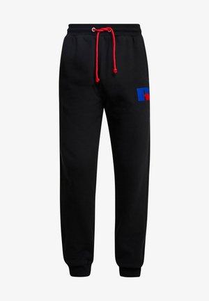 ERNEST - Spodnie treningowe - black