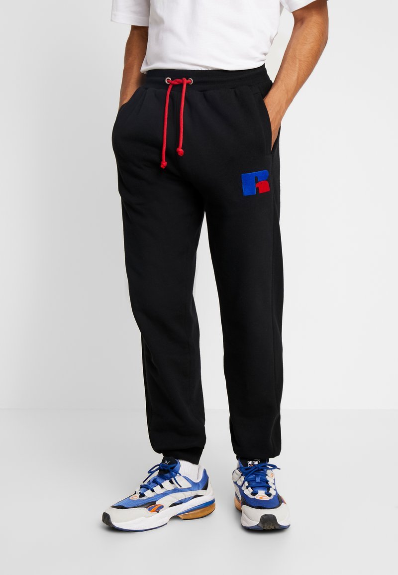Russell Athletic Eagle R - ERNEST - Pantaloni sportivi - black