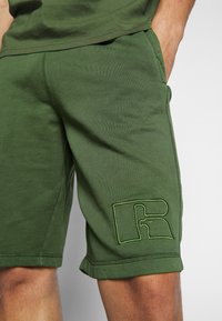 Russell Athletic Eagle R - MATTIA - Tracksuit bottoms - cypress - 5