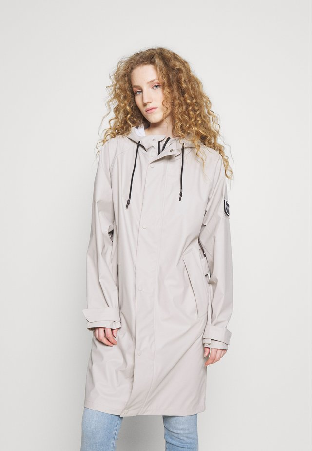 WATERPROOF VIMMERBY - Trenchcoat - light sand