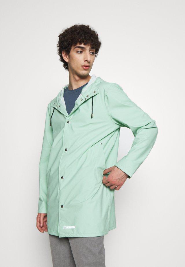 STOCKHOLM - Waterproof jacket - green mint